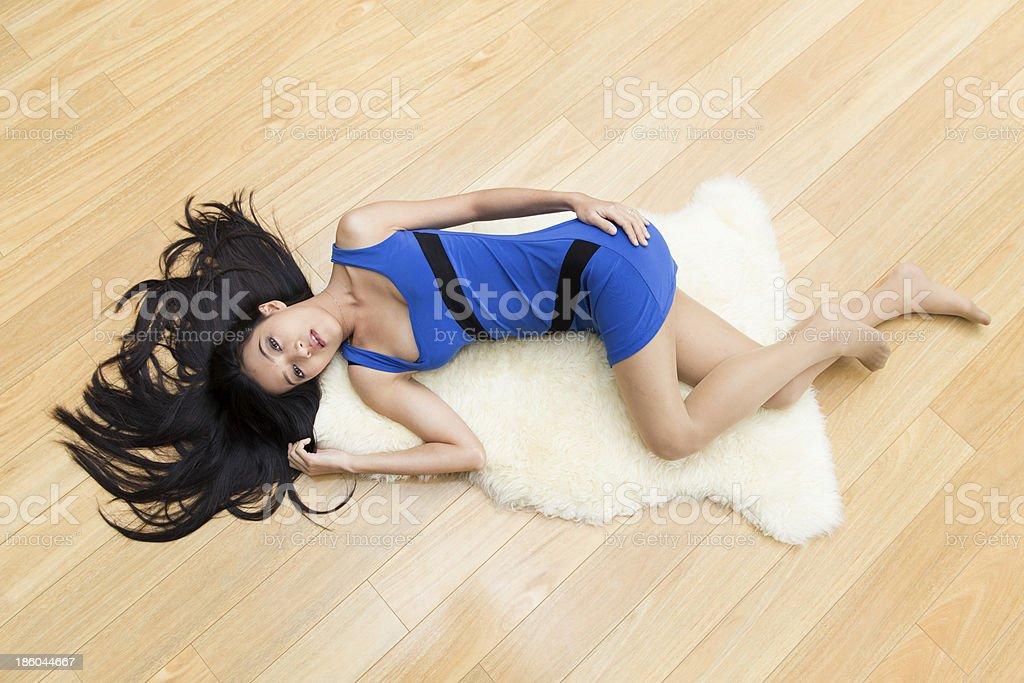 Girl laying on the floor stok fotoğrafı