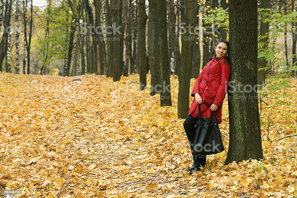Girl Leaning On Tree royalty-free stock photo