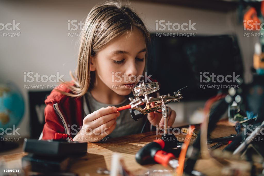 Girl learning robotics stock photo