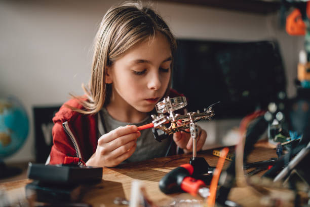 Girl learning robotics stock photo
