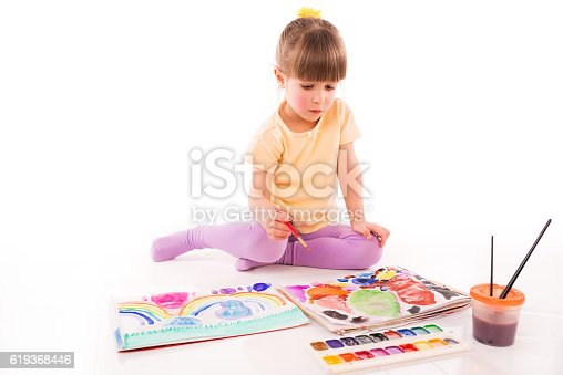 istock Girl Learning to Draw 619368446