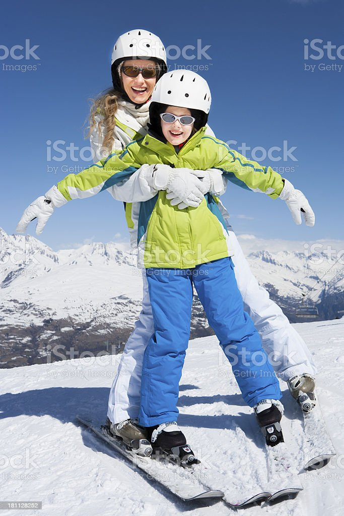 Girl Learning to Ski with Mother royalty-free stock photo
