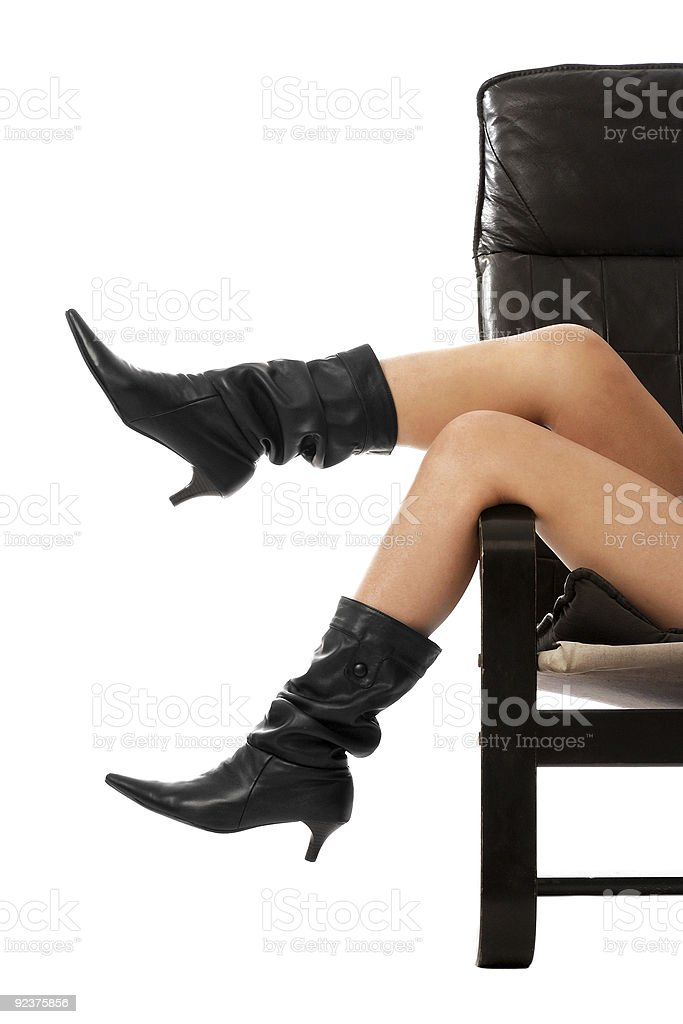 Girl legs hanging from chair royalty-free stock photo