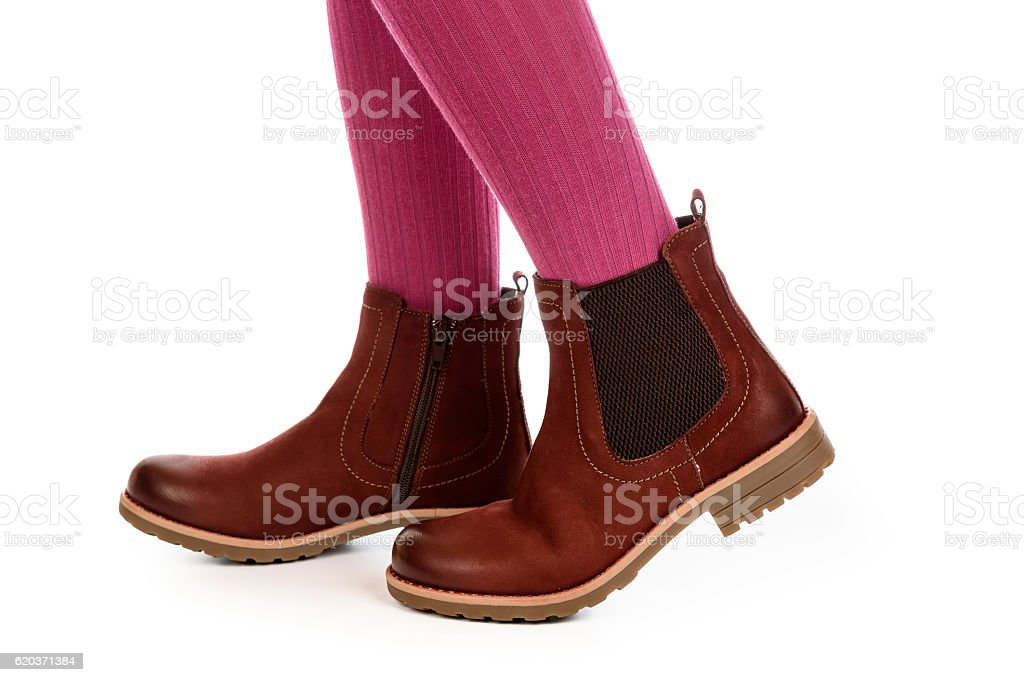 Girl legs in new winter boots on white background. foto de stock royalty-free