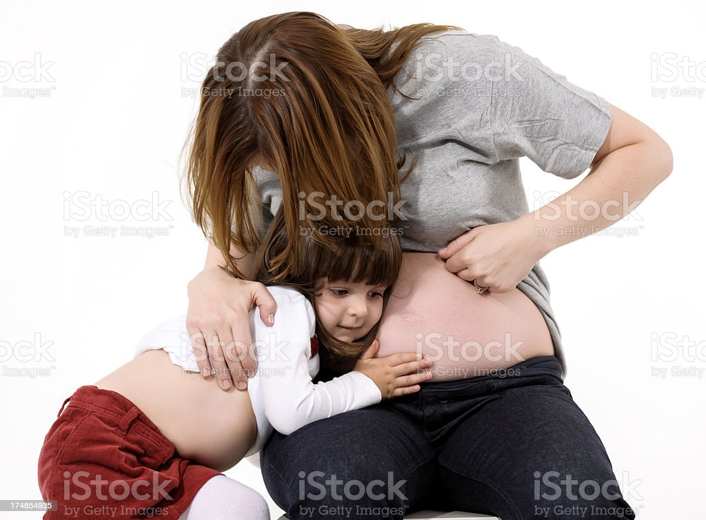 girl listening her mother tummy royalty-free stock photo