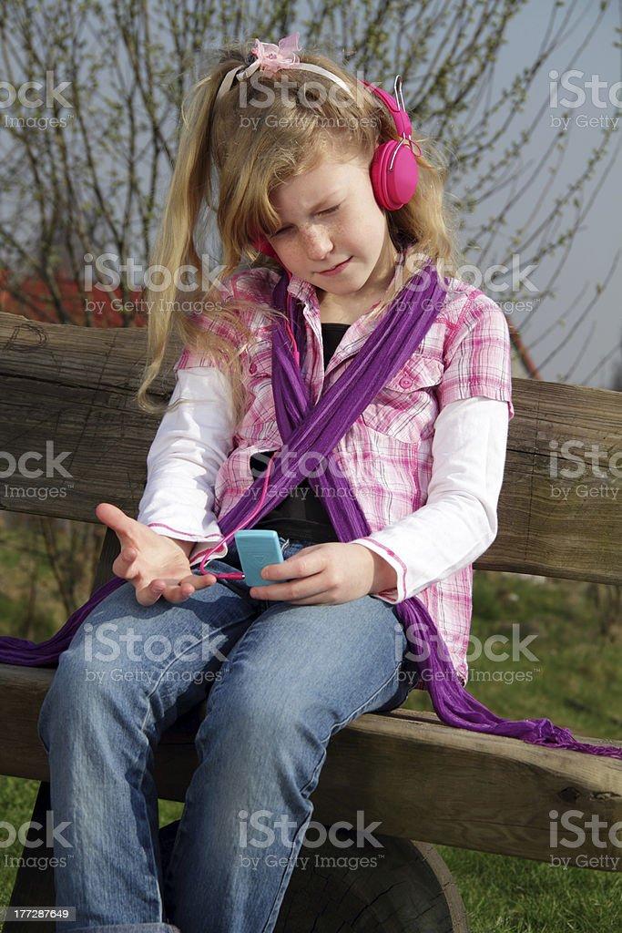 girl listening to beats stock photo