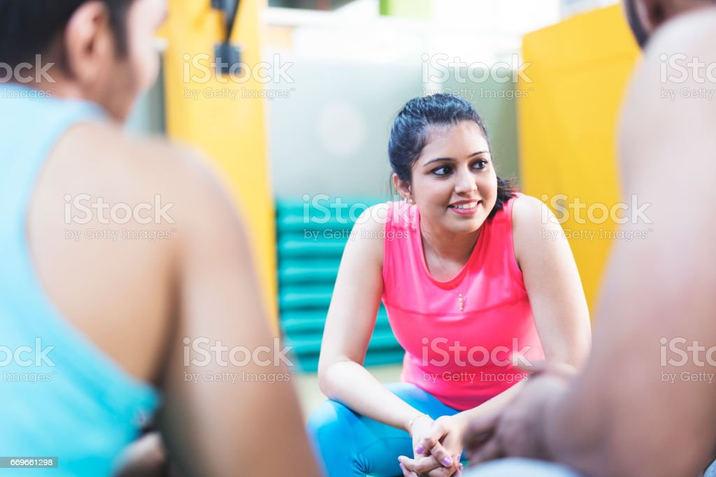 Girl listening to fitness fanatics during a training class break stock photo