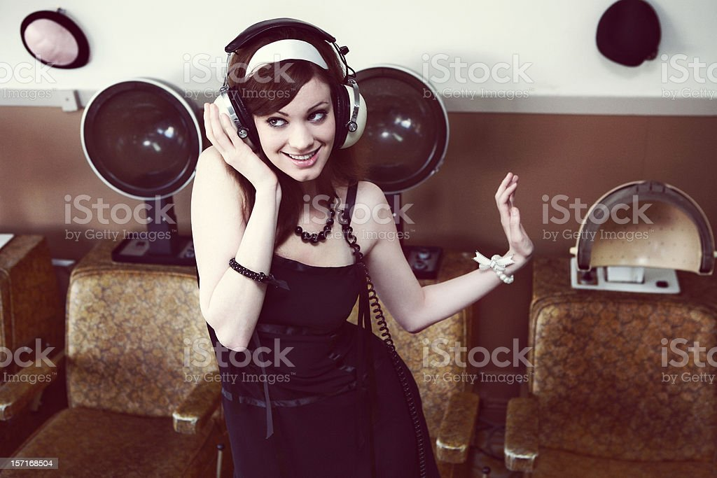 Girl Listening to Headphones at a Beauty Salon royalty-free stock photo