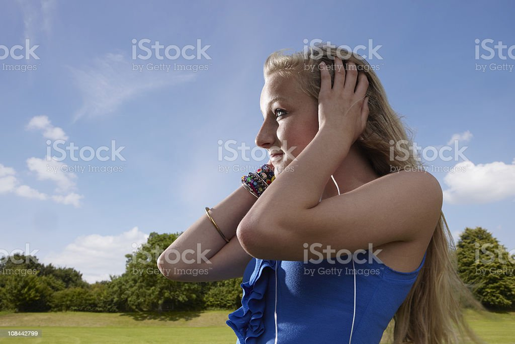 Girl listening to headphones stock photo