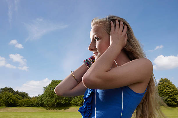 girl listening to headphones - human limb stock photos and pictures