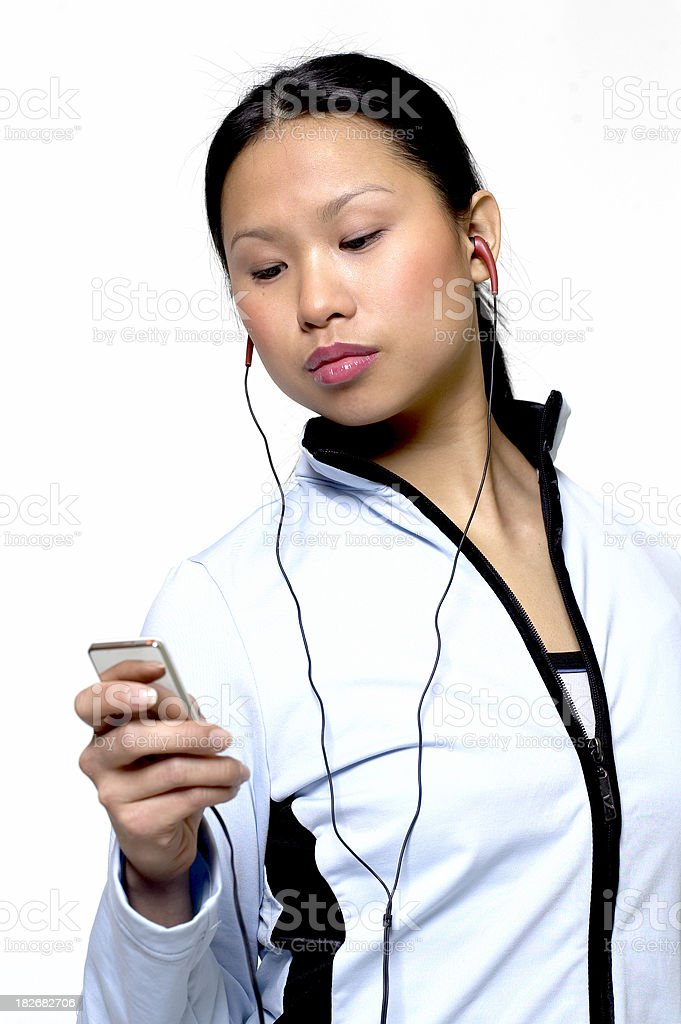 girl listening to mp3 player royalty-free stock photo