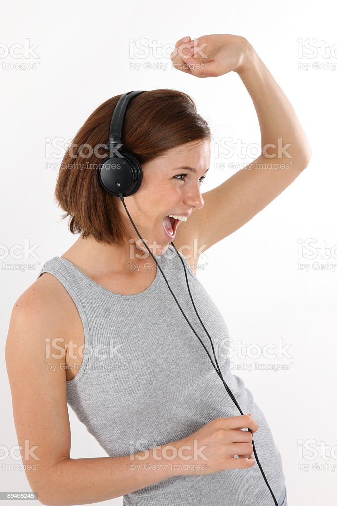 Girl listening to music dancing and singing 免版稅 stock photo