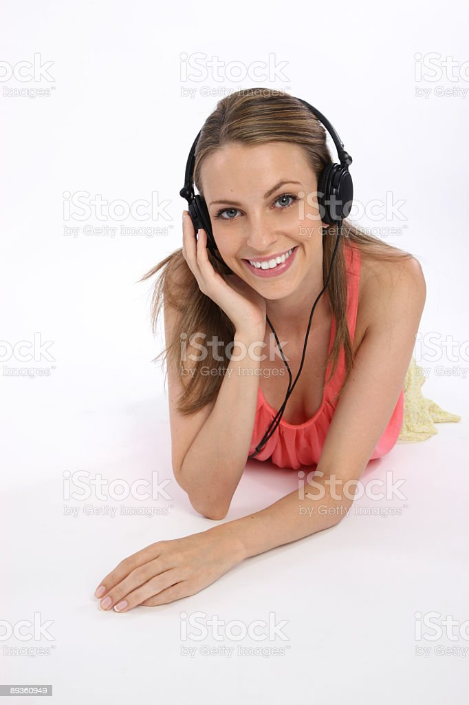 Girl listening to music royaltyfri bildbanksbilder