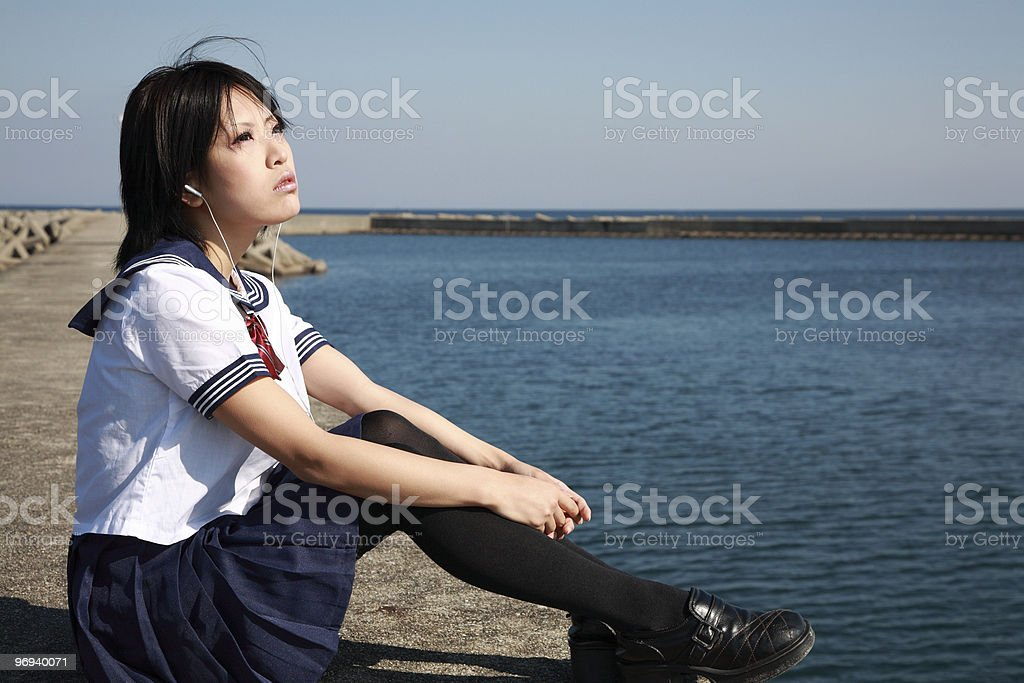 Girl listening to music royalty-free stock photo