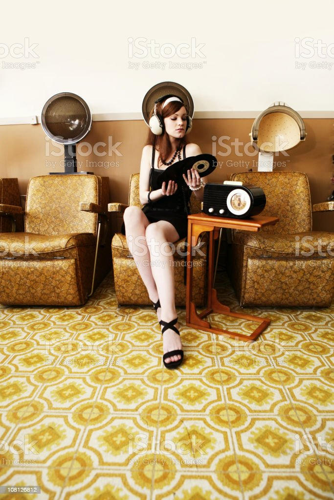 Girl Listening to Music Under a Dryer royalty-free stock photo