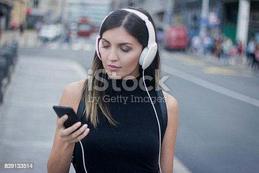 istock girl listening to the music 839133514