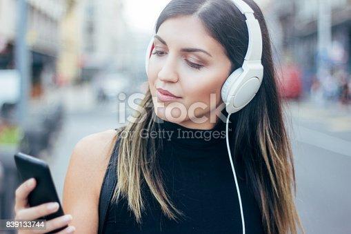 istock girl listening to the music 839133744
