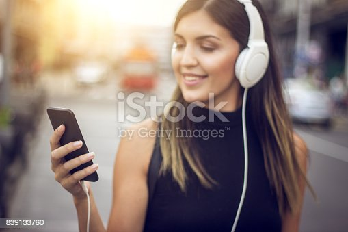 istock girl listening to the music 839133760