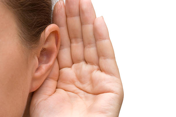 Girl listening with her hand on an ear  human ear stock pictures, royalty-free photos & images