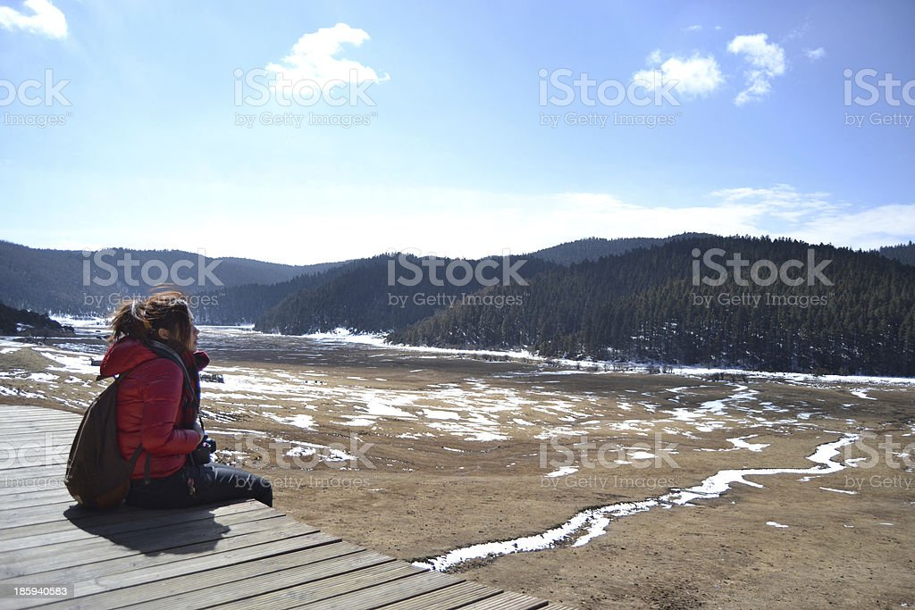 Girl look forward to the snow meadow royalty-free stock photo