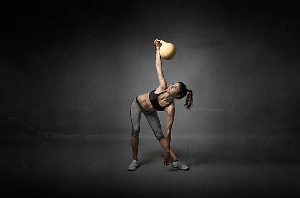 girl looking a kettlebell