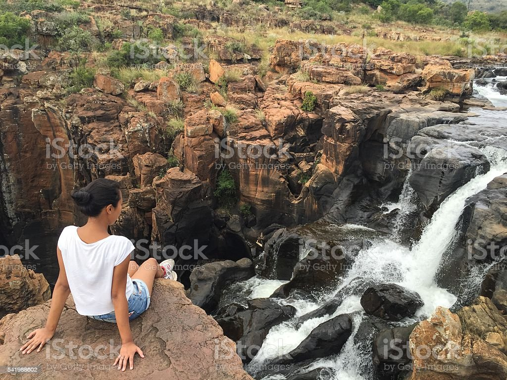 Girl looking at a waterfall stock photo
