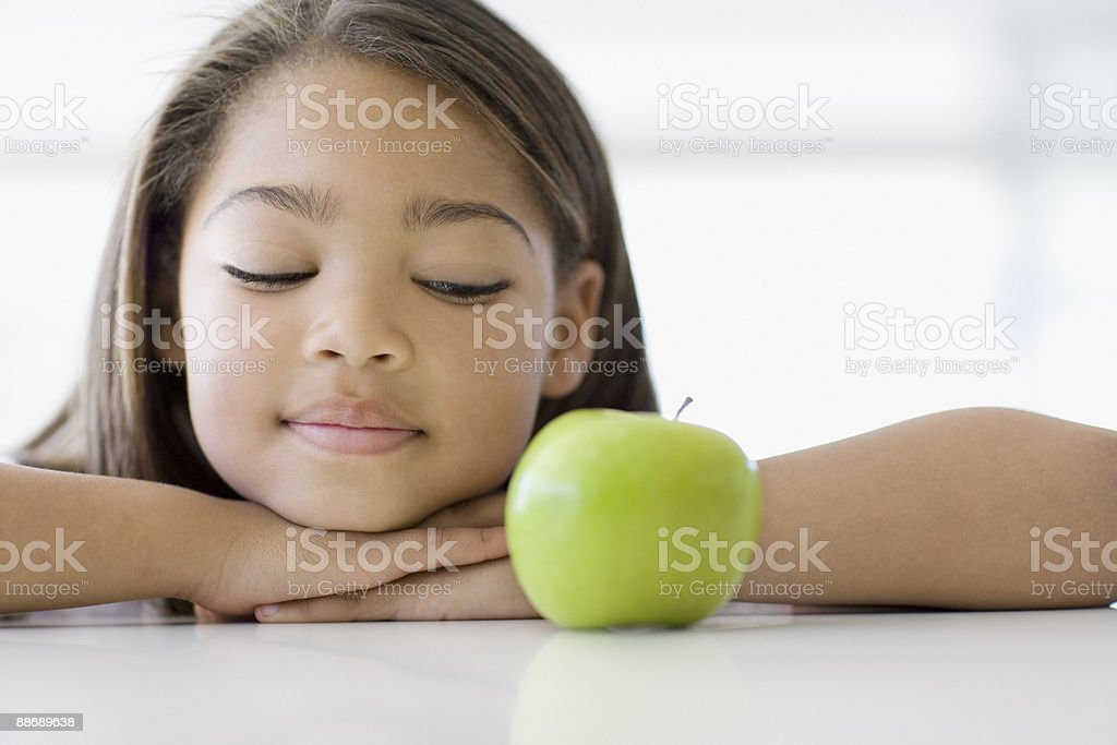 Girl looking at apple royalty-free stock photo