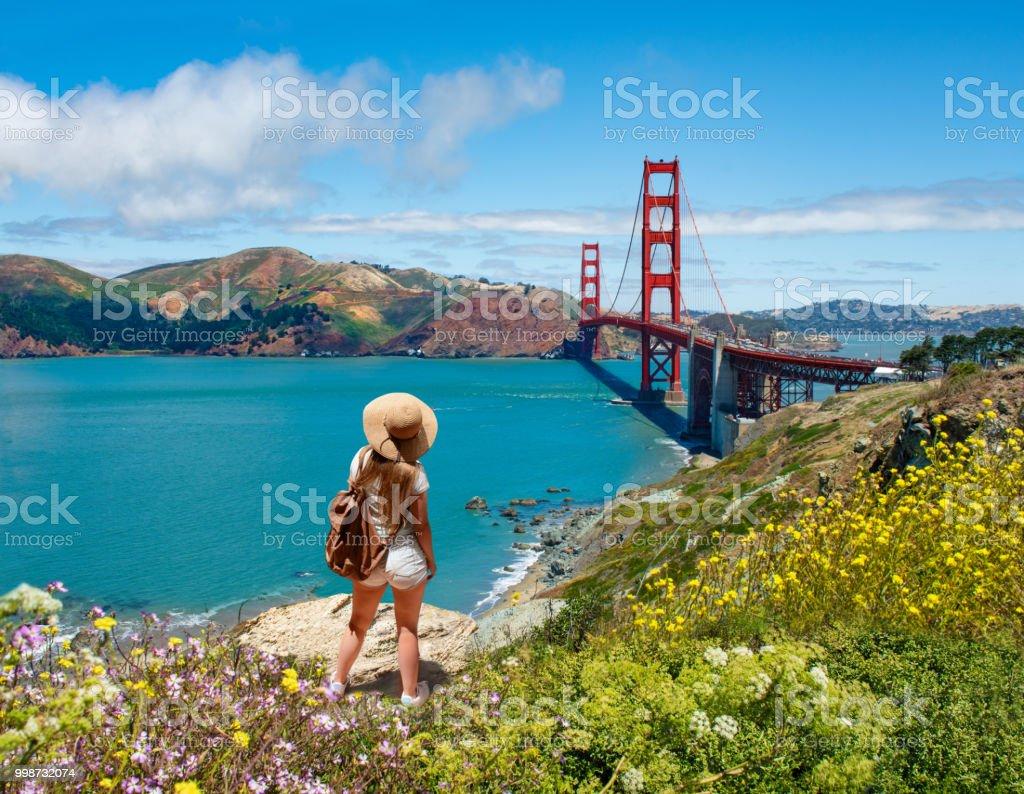 Girl looking at beautiful summer coastal landscape, on hiking trip. stock photo
