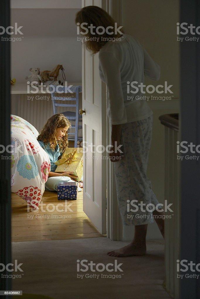 Girl looking at Christmas gift stock photo