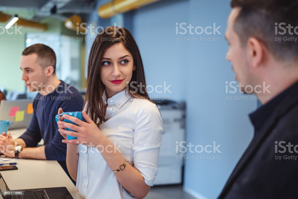 Girl looking at her colleague with love in her eyes stock photo