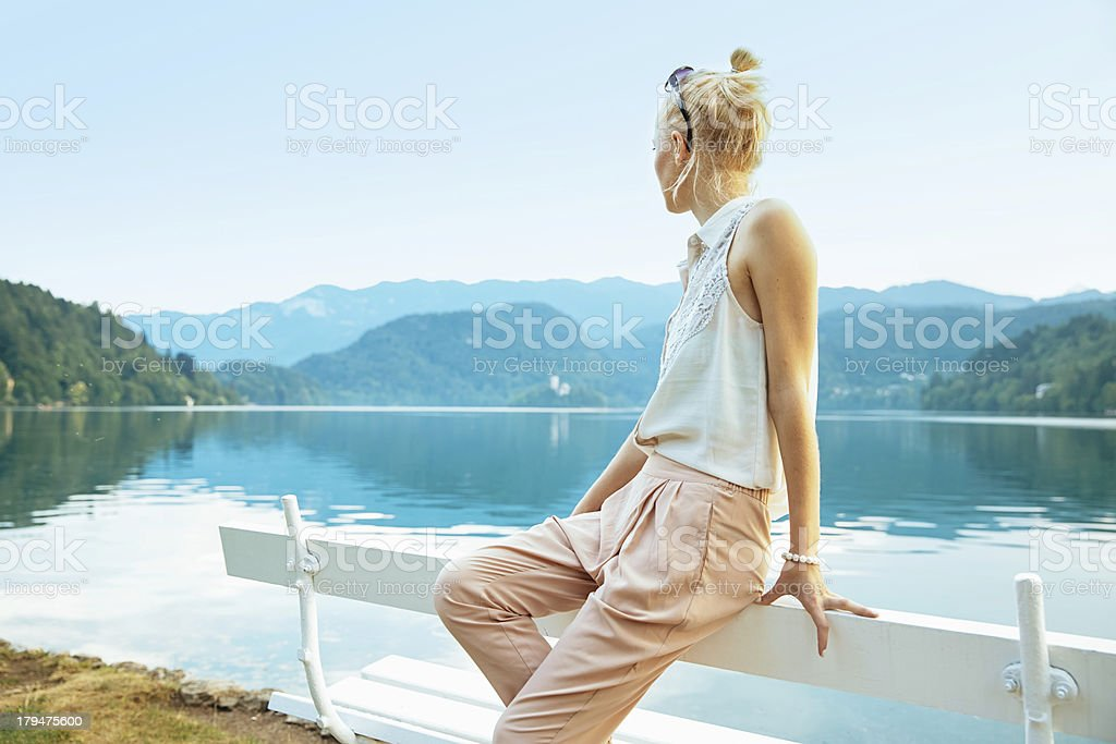 Girl Looking at Mountain Lake View royalty-free stock photo