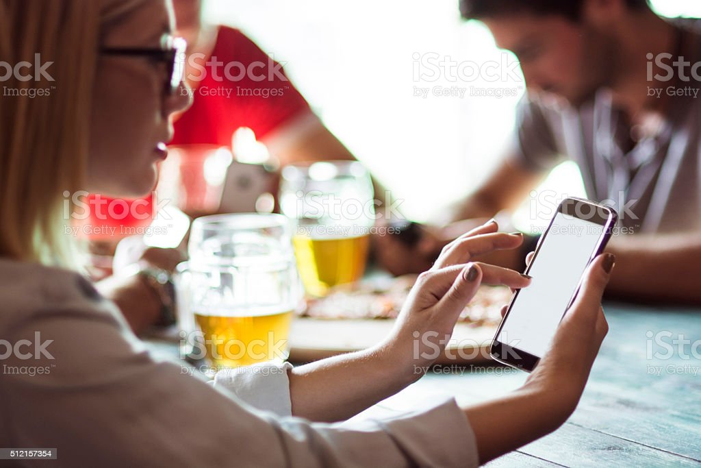 Girl looking at smartphone stock photo