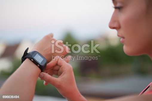 Girl is looking at her sport watch ready for running