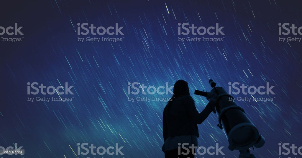 Girl looking at the stars through a telescope. Elements of this image...