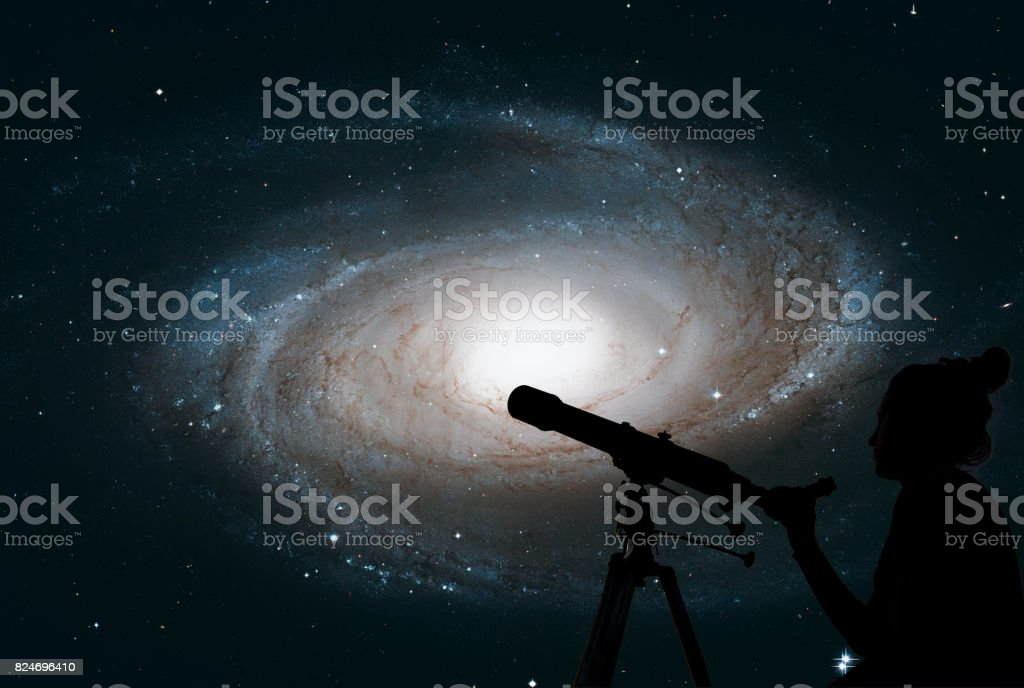 Girl looking at the stars with telescope. Bode's Galaxy, M81, Spiral galaxy in the constellation Ursa Major. stock photo