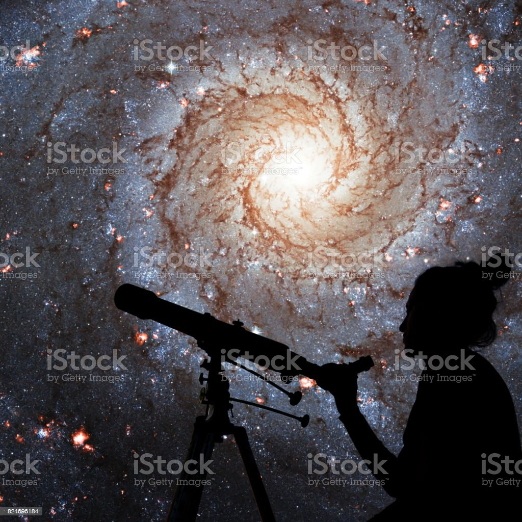 Girl looking at the stars with telescope. Messier 74,  NGC 628 Spiral galaxy in the constellation Pisces. stock photo