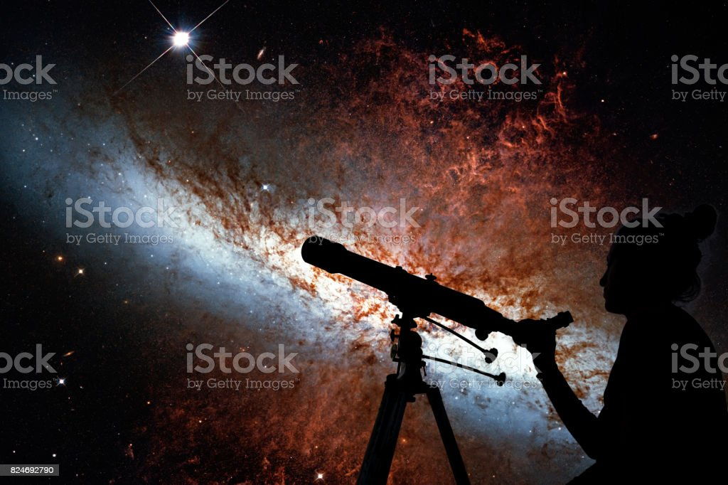 Girl looking at the stars with telescope. Messier 82, Cigar Galaxy or M82 in the constellation Ursa Major stock photo