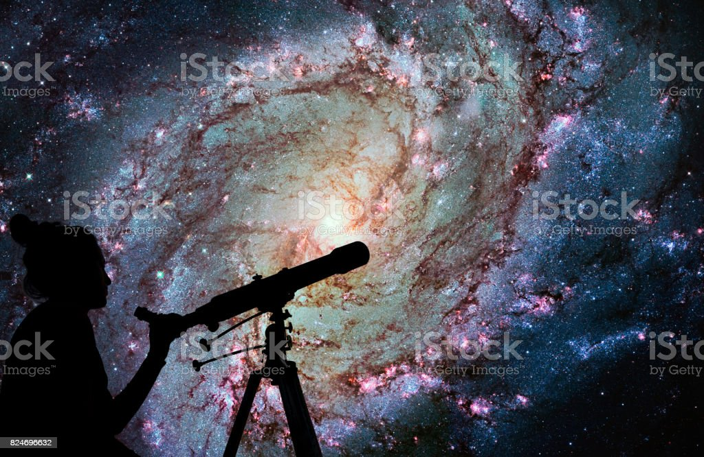 Girl looking at the stars with telescope. Messier 83, Southern Pinwheel Galaxy, M83 in the constellation Hydra. stock photo