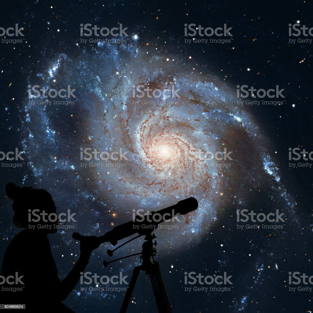 Girl looking at the stars with telescope. Pinwheel Galaxy Messier 101, M101 in the constellation Ursa Major stock photo