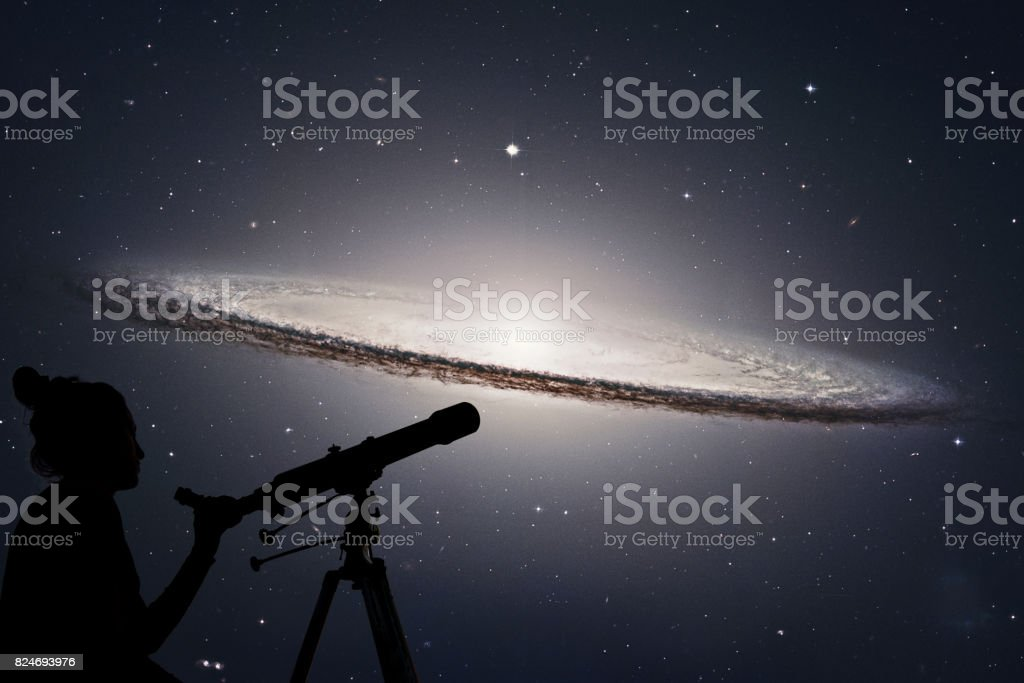 Girl looking at the stars with telescope. Sombrero Galaxy M104  in constellation Virgo. stock photo
