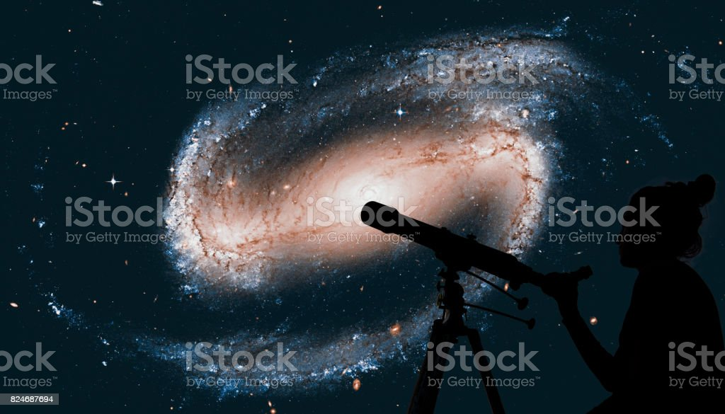 Girl looking at the stars with telescope. Spiral galaxy in the constellation Eridanus NGC 1300 stock photo