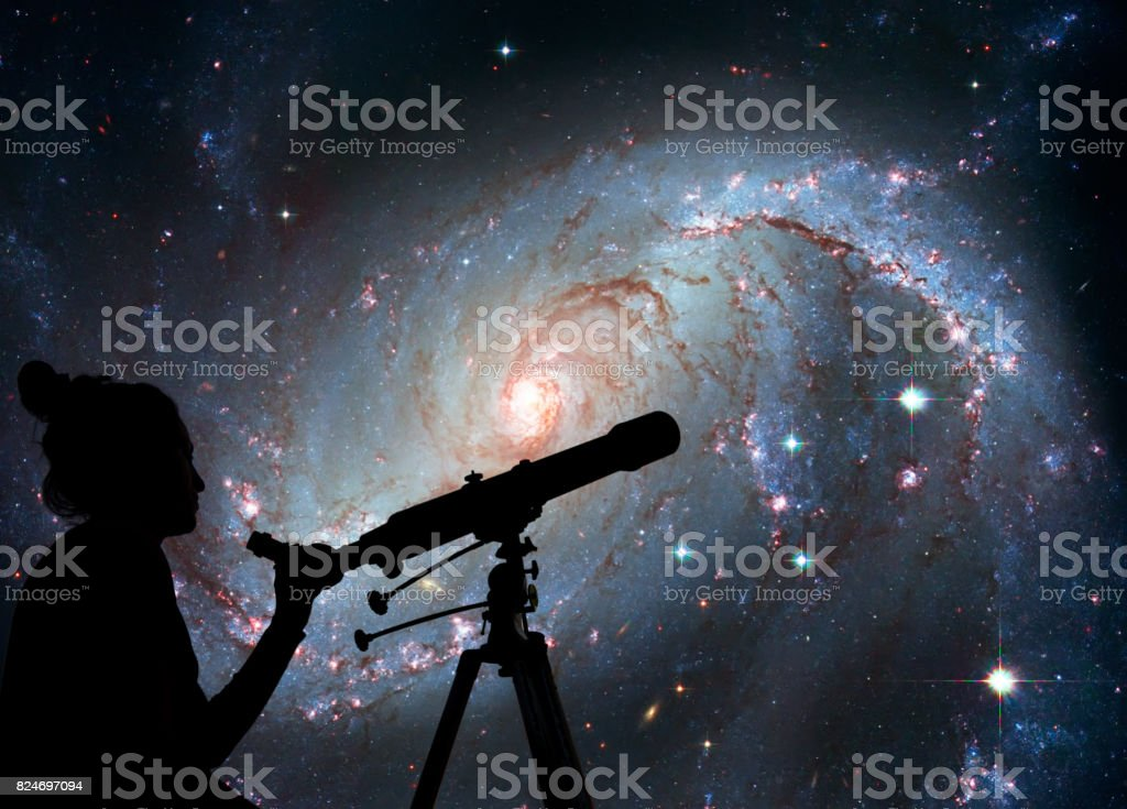Girl looking at the stars with telescope. Stellar Nursery NGC 1672. Spiral galaxy in the constellation Dorado stock photo