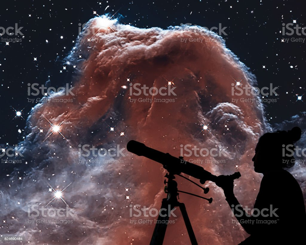 Girl looking at the stars with telescope. The Horsehead Nebula in the constellation of Orion (The Hunter) stock photo