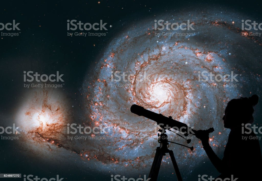 Girl looking at the stars with telescope. Whirlpool Galaxy. Spiral galaxy M51 or NGC 5194 stock photo