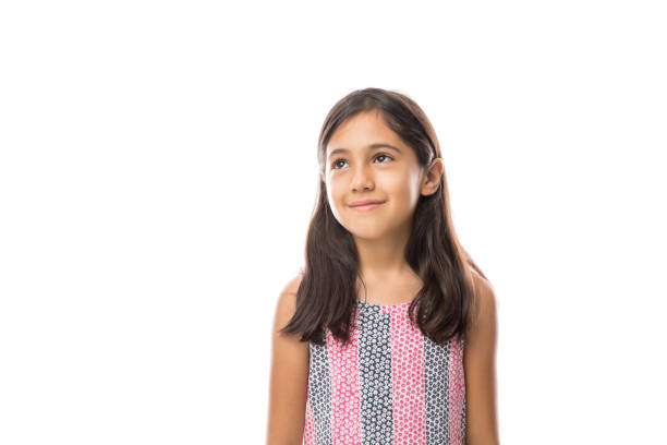 Girl looking away smiling on a light background portrait stock photo