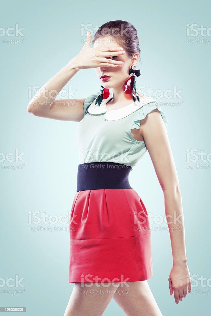 Girl looking between her fingers royalty-free stock photo