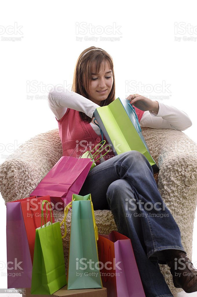 girl looking in her shopping bags royalty-free stock photo