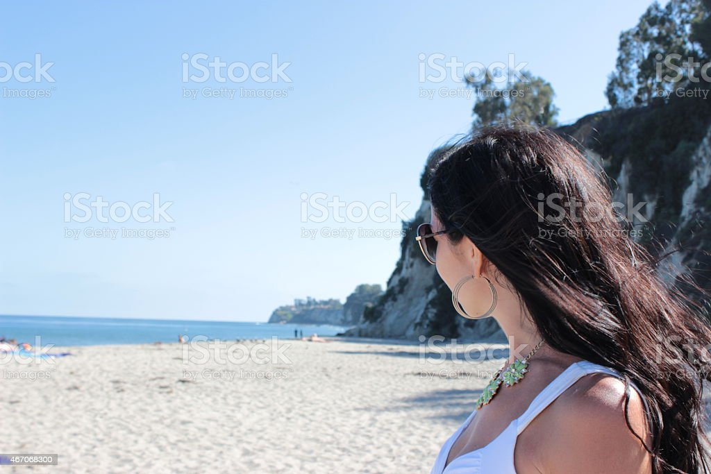 Girl looking into the distance stock photo