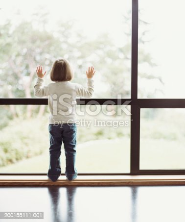 istock Girl (2-4) looking out window, rear view 200155111-001