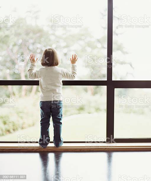 Girl Looking Out Window Rear View Stock Photo - Download Image Now